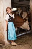 Girl in a cow stable Royalty Free Stock Image