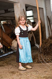 Girl in a cow stable Royalty Free Stock Images