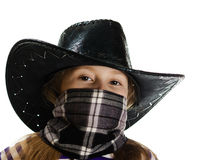 Girl cowboy in a black hat Stock Photography