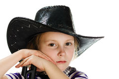 Girl cowboy in a black hat Royalty Free Stock Photos
