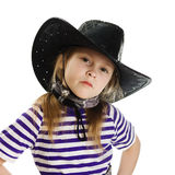 Girl cowboy in a black hat Royalty Free Stock Photography