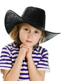 Girl cowboy in a black hat Stock Photo