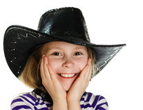 Girl cowboy in a black hat Royalty Free Stock Image