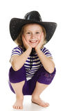 Girl cowboy in a black hat Stock Image