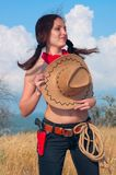 Girl cowboy in the field with  hat on  chest Stock Photos
