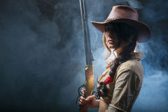 Girl cowboy. With a gun Royalty Free Stock Photography