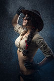Girl cowboy. Beautiful girl cowboy on a gray background Royalty Free Stock Photography