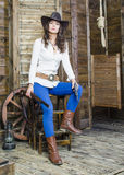 The girl the cowboy with a gun and a gun royalty free stock photography