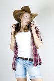 A girl in a cowboy hat Stock Photography