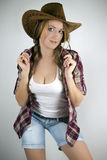 A girl in a cowboy hat Royalty Free Stock Photos
