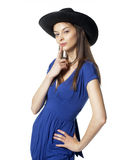 Girl in cowboy hat. At stylized pose Stock Photography