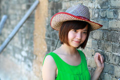 Girl in a cowboy hat. Smiling girl dressed in a nice green skirt Stock Photography