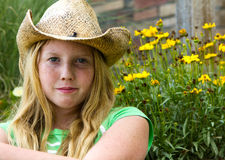 Girl in cowboy hat. Stock Photos