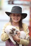 Girl in cowboy hat Stock Image