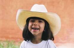 Girl in Cowboy Hat. Girl wearing her dad's cowboy hat Stock Photo
