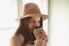 The girl cowboy in hat with coffee Stock Photography