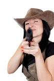 Girl in a cowboy hat with a gun Stock Photography