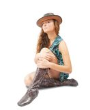Girl in cowboy hat and high shoes over white Stock Photography
