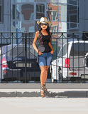 Girl in a cowboy hat on a hot day in the city Royalty Free Stock Photo