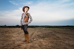 Girl with cowboy hat Stock Images