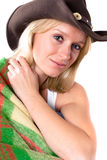 Girl in a cowboy hat with wrapped in a plaid Stock Photo