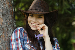 Girl in a cowboy hat Royalty Free Stock Images