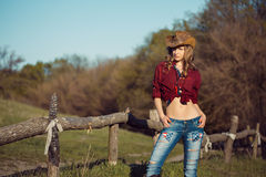 Girl with cowboy hat Stock Photos