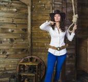Girl cowboy near the gallows Stock Photos