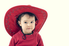 Girl cowboy in a red hat on a white Stock Photo