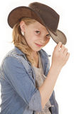 Girl with cowboy at touch rim close Royalty Free Stock Photo