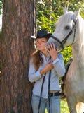 Girl-cowboy and white horse Stock Photos