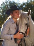 Girl-cowboy and white horse Stock Photography