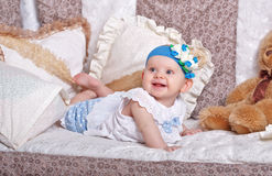 Girl in a cradle among the pillows. Stock Photography