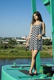Girl on crane Stock Photo