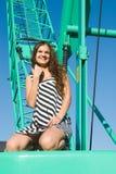 Girl on crane Stock Photos