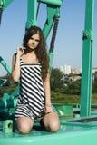 Girl on crane Stock Image
