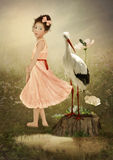 Girl, Crane and Frogs Stock Images