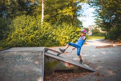 A girl crashes while skateboarding on a ramp royalty free stock image