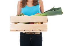 Girl with crate vegetables Royalty Free Stock Images