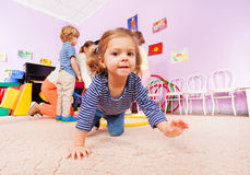 Girl crawl on active class lesson in kindergarten Royalty Free Stock Photos