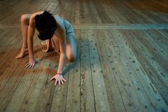 Girl crawling on the floor in  ballroom Stock Photography