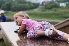 The girl crawling up the hill. Royalty Free Stock Photo