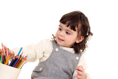 Girl with crayons Royalty Free Stock Photo