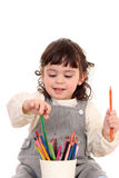 Girl with crayons Stock Photography