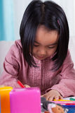 Girl with crayons Royalty Free Stock Images