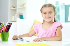 Girl with crayons Stock Image