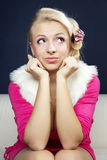 Girl with crazy face. Sitting on sofa stock photos