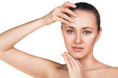 Girl with cream dots on face. Isolated on white royalty free stock image