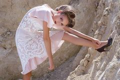 The girl in a cream dress Royalty Free Stock Photo
