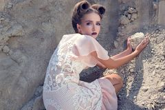 The girl in a cream dress Royalty Free Stock Image
